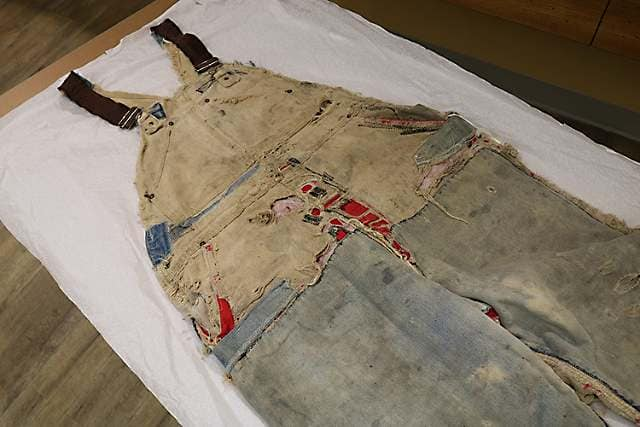 Patched overalls (originally brown duck), purchased 1976